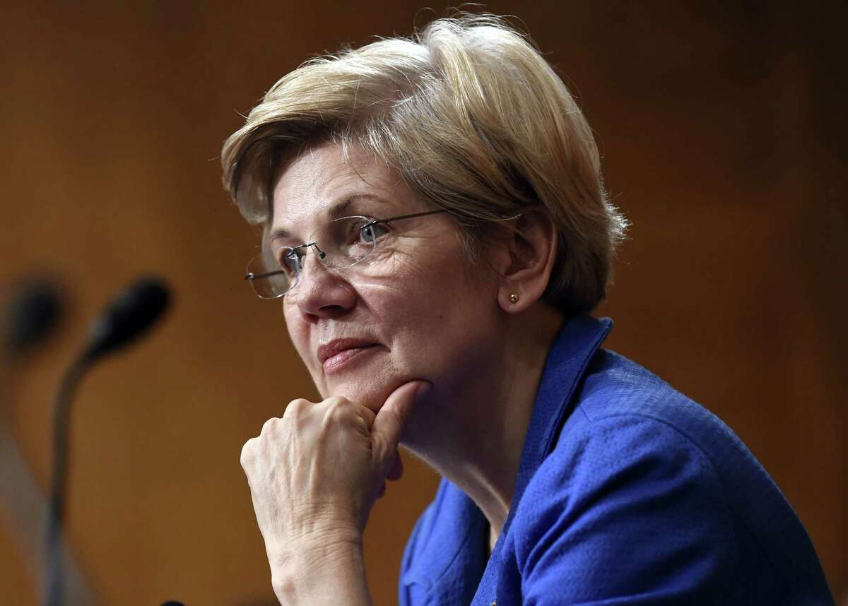 In this July 16, 2015 photo, Sen. Elizabeth Warren, D-Mass., listens to Federal Reserve Chair Janet Yellen testify before the Senate Banking, Housing, Urban Affairs Committee on Capitol Hill in Washington.
