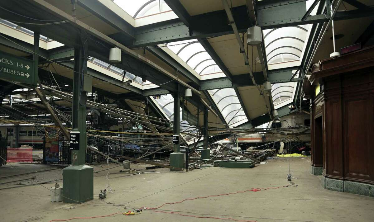 This Oct. 1, 2016, file photo provided by the National Transportation Safety Board shows damage done to the Hoboken Terminal in Hoboken, N.J., after a commuter train crash that killed one person and injured more than 100 others. Lawmakers investigating September's deadly New Jersey Transit train crash could finally get a chance to question top agency officials who skipped out on an oversight hearing last month. NJ Transit says new executive director Steve Santoro and other key leaders will testify before the legislative committee on Friday, Nov. 4, 2016.