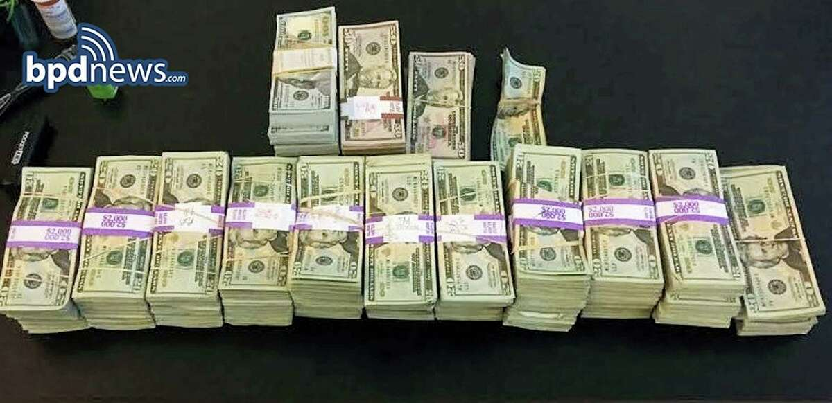 """In this photo released July 5, 2016, by the Boston Police Department, stacks of money totaling about $187,000 that were left in a taxi are displayed in Boston. Boston police said cab driver Raymond """"Buzzy"""" MacCausland picked up a rider in Boston on Saturday who left a backpack containing the money in the taxi. After being unable to locate the man, MacCausland drove to police headquarters to turn in the cash. The unidentified rider was reunited with his money, which turned out had been inherited. MacCausland received a $100 reward."""