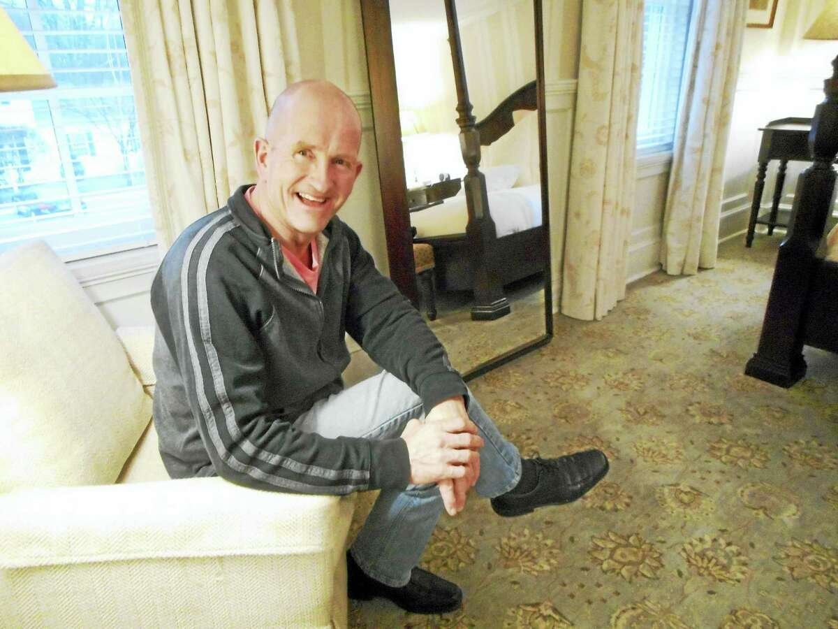 """Eddie """"The Eagle"""" Edwards takes a break from a hectic interview schedule Wednesday in Salisbury. He is the subject of a new movie based on his Olympic bid in 1988 in Calgary."""