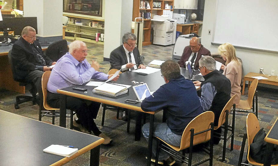 Cromwell Board of Finance members meet to set the tax rate Tuesday after voters passed the budget. Photo: Jeff Mill — The Middletown Press