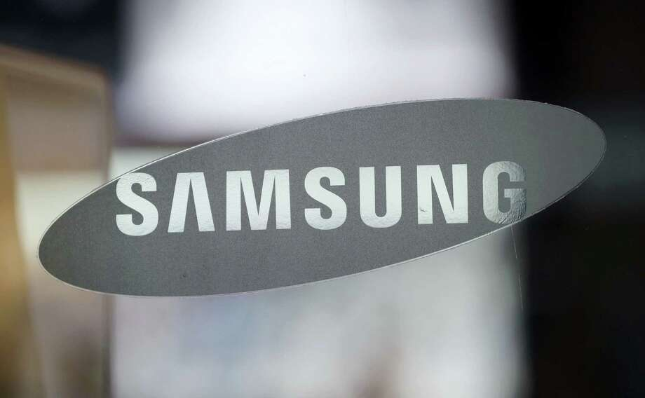 In this file photo, the corporate logo of Samsung Electronics Co. is seen at its shop in Seoul, South Korea. Photo: Lee Jin-man — The Associated Press  / Copyright 2016 The Associated Press. All rights reserved.