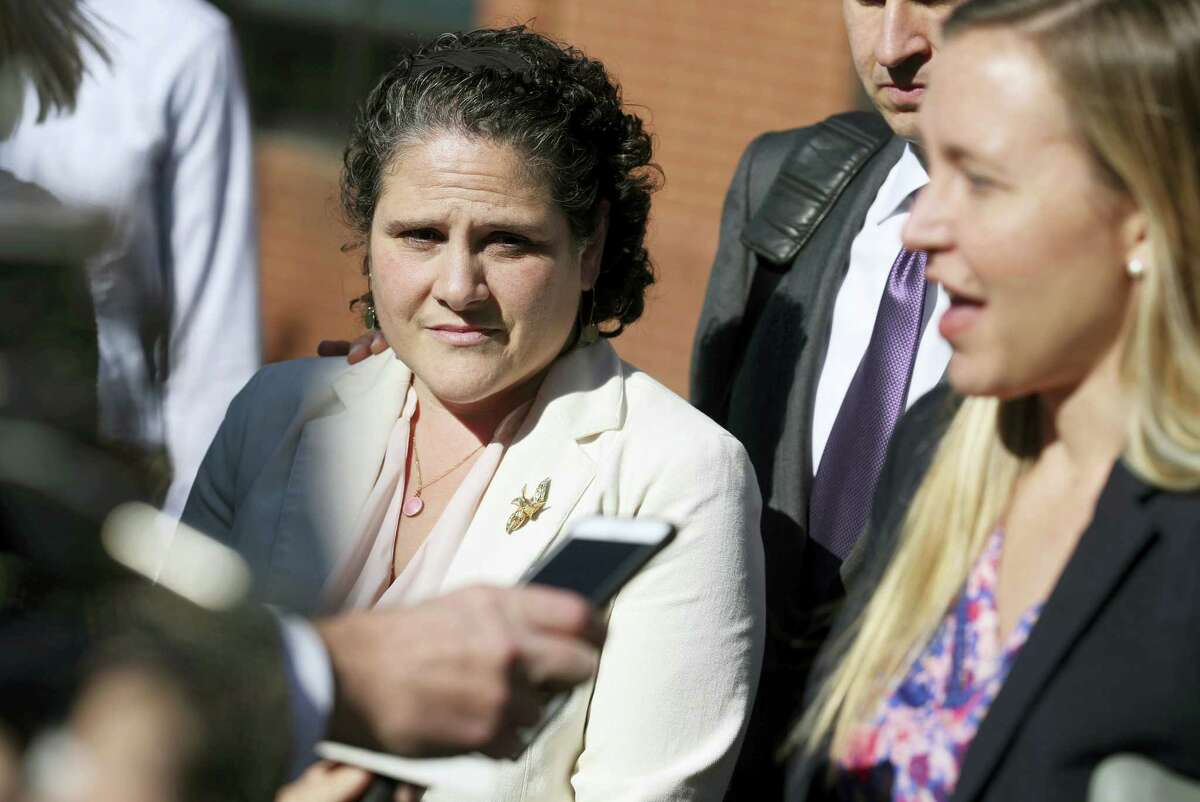 University of Virginia administrator Nicole Eramo, left, listens to attorney Libby Locke, right, speak with the media outside the federal courthouse in Charlottesville, Va., on Friday.