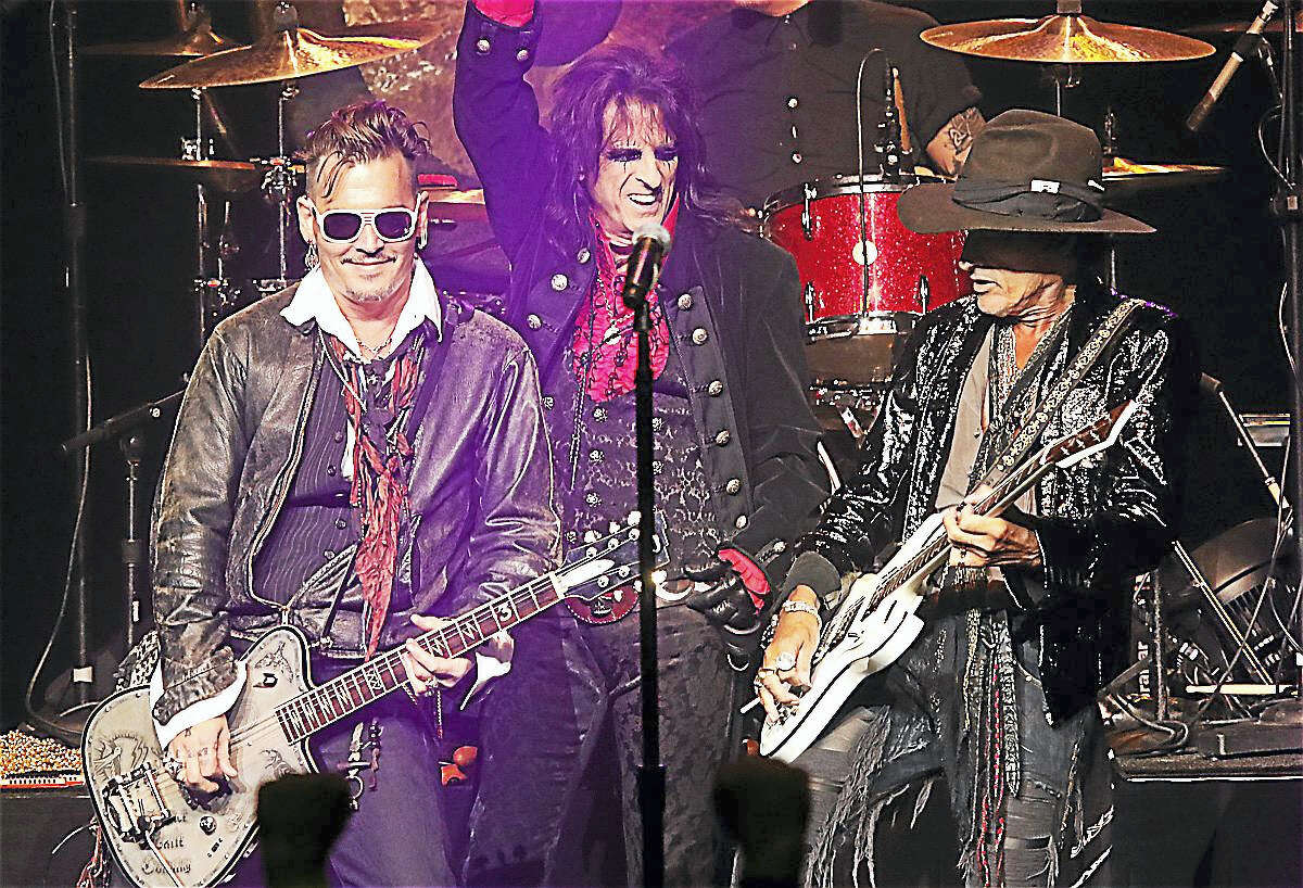 Photo by John AtashianThe Hollywood Vampires featuring actor Johnny Depp, singer Alice Cooper and guitarist Joe Perry of Aerosmith are shown jamming on stage during their performance at Foxwoods Resort Casino July 2. The show was packed with classic rock hit after hit performed by a powerhouse band that also included Matt Sorum on drums, Robert DeLeo on bass, Tommy Henriksen on guitar and Bruce Witkin on Keyboards and guitar. This was a fun night of great rock songs played by a super group of musicians enjoying each other and the packed crowd of fans on a summer night.
