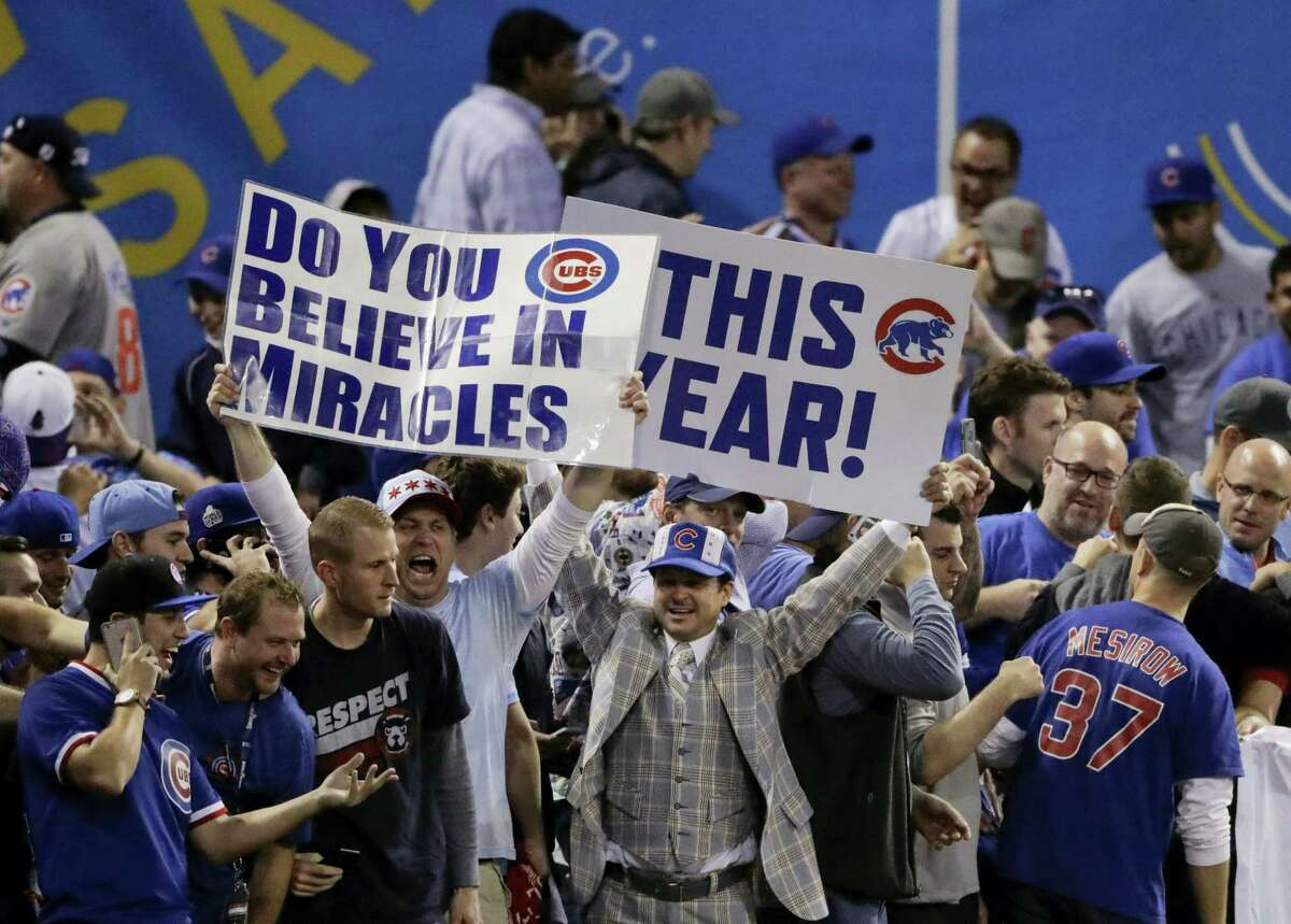 Fans react after the Chicago Cubs won Game 7 of the Major League Baseball World Series against the Cleveland Indians Thursday, Nov. 3, 2016 in Cleveland. The Cubs won 8-7 in 10 innings to win the series 4-3.