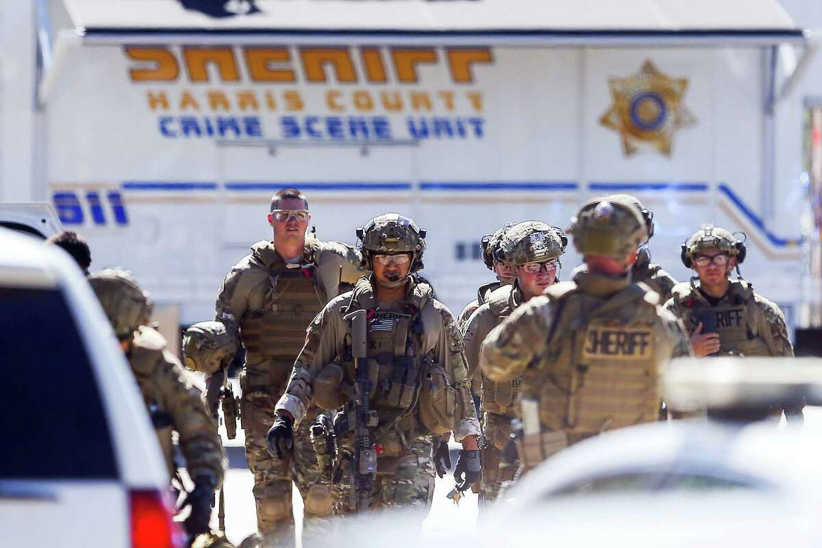 Sheriff's deputies exit Knight Transportation after an employee, who was recently fired, returned to the business and fatally shot an employee before killing himself, Wednesday, May 4, 2016, in Katy, Texas.
