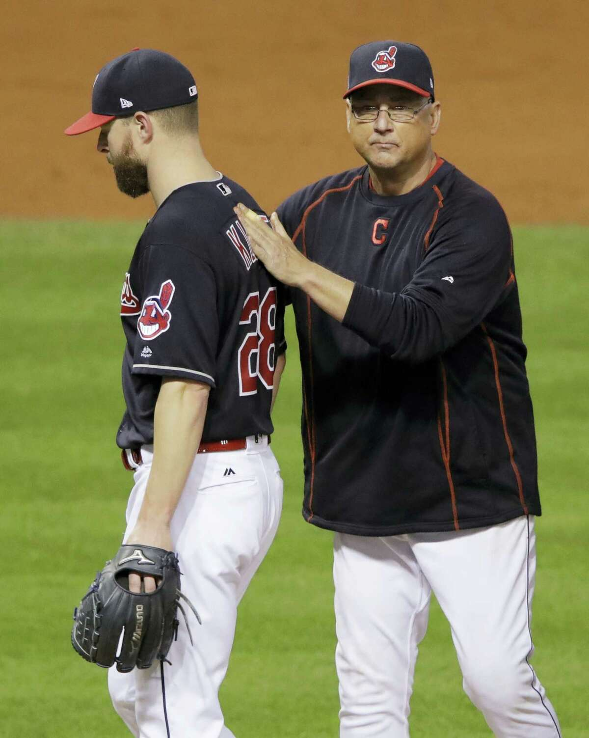 Indians manager Terry Francona takes starting pitcher Corey Kluber out of the game during the fifth inning of Game 7 on Wednesday.