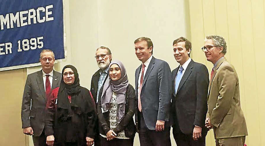 Madiha Shafqat poses with her parents Nuzhat Ullah and Shafqat Ullah, U.S. Sen. Chris Murphy, state Rep. Matthew Lesser, and Vincent Capece, president and CEO of Middlesex Hospital. Photo: Sam Norton — The Middletown Press