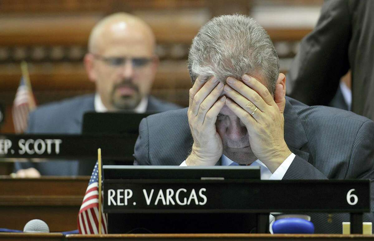 Rep. Edwin Vargas of Hartford gestures as he looks at his computer screen during the last day of the legislative session in Hartford, Wednesday, May 4, 2016. Democratic leaders scrapped plans Wednesday evening to push through an 11th-hour budget deal on the final day of the legislative session, acknowledging there was not enough time to pass the bill before a fast-approaching midnight adjournment.