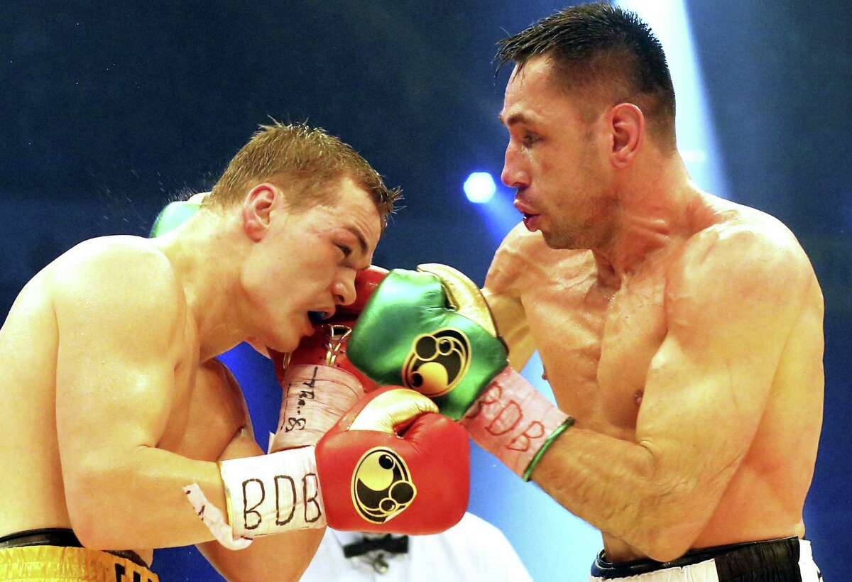 In this Feb. 20, 2016 picture, Germany's Felix Sturm, right, challenges with Russia's Fedor Chudinov, during a WBA super middleweight title bout in Oberhausen, Germany. German prosecutors have opened a criminal investigation against Sturm because of doping.