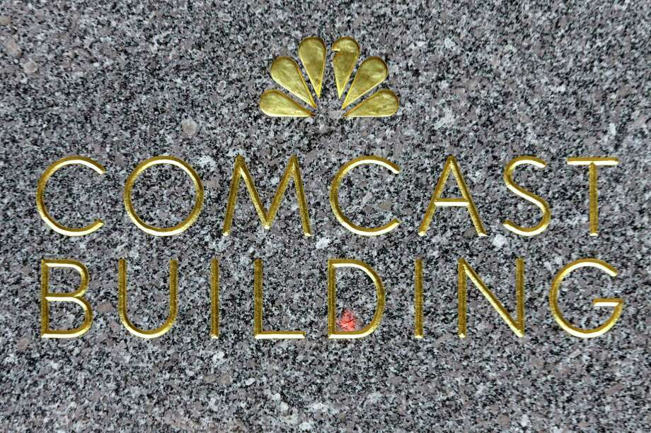 This Thursday, July 23, 2015, photo, shows the Comcast building sign at Rockefeller Center, in New York. Comcast reports financial earnings on Wednesday, Feb. 3, 2016. Photo: THE ASSOCIATED PRESS / AP