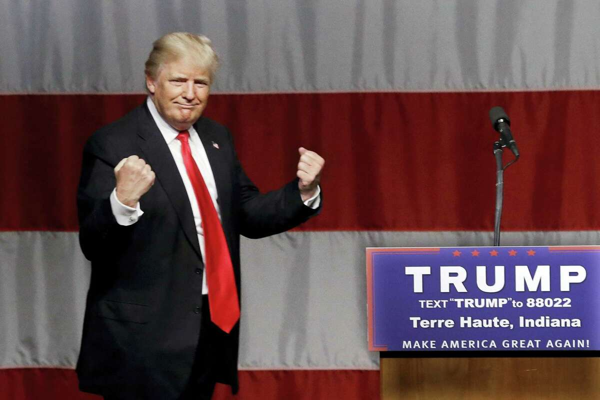 In this Sunday, May 1, 2016 file photo, Republican presidential candidate Donald Trump reacts to a song during a campaign rally at the Indiana Theater in Terre Haute, Ind.