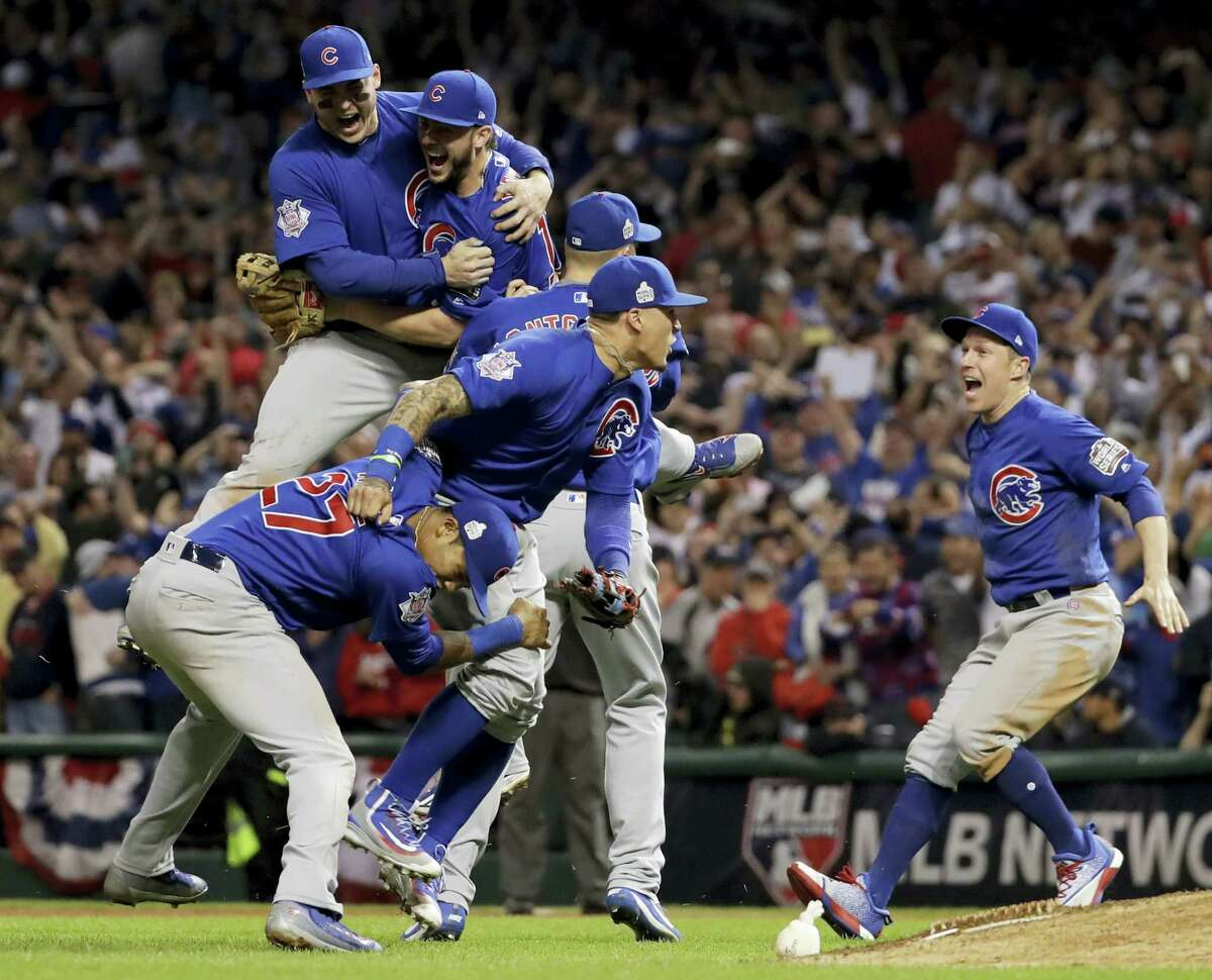 Members of the Chicago Cubs celebrate after winning Game 7 of the World Series against the Indians on Thursday.