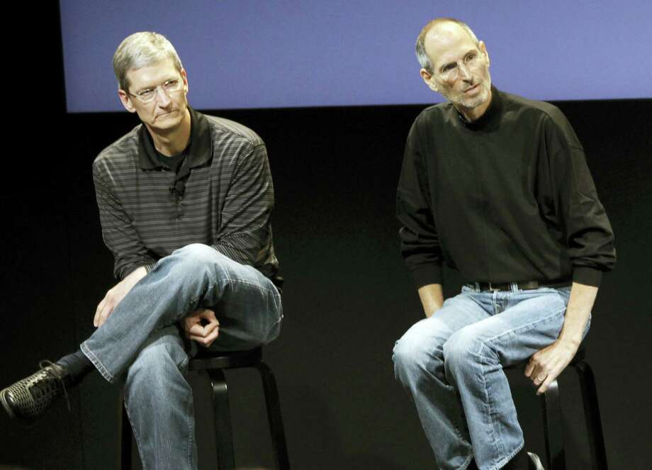 """This July 16, 2010 photo shows Apple's Tim Cook, left, and Steve Jobs, right, during a meeting at Apple in Cupertino, Calif. Apple wants to encourage millions of iPhone owners to register as organ donors through a software update that will add an easy sign-up button to the health information app that comes installed on every smartphone the company makes. CEO Cook says he hopes the new software, set for limited release in early July 2016, will help ease a critical and longstanding donor shortage. He said the problem hit home when his friend and former boss, Apple co-founder Jobs, endured an """"excruciating"""" wait for a liver transplant in 2009. Photo: AP Photo/Paul Sakuma, File  / AP2010"""