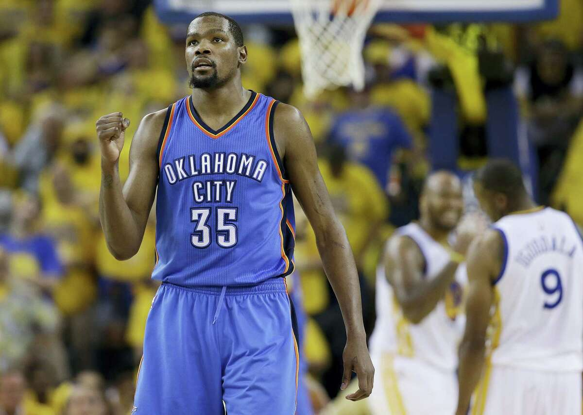 FILE - In this May 30 file photo, Oklahoma City Thunder forward Kevin Durant reacts during the second half of Game 7 of the NBA basketball Western Conference finals against the Golden State Warriors. Durant announced Monday that he will sign with the Golden State Warriors.