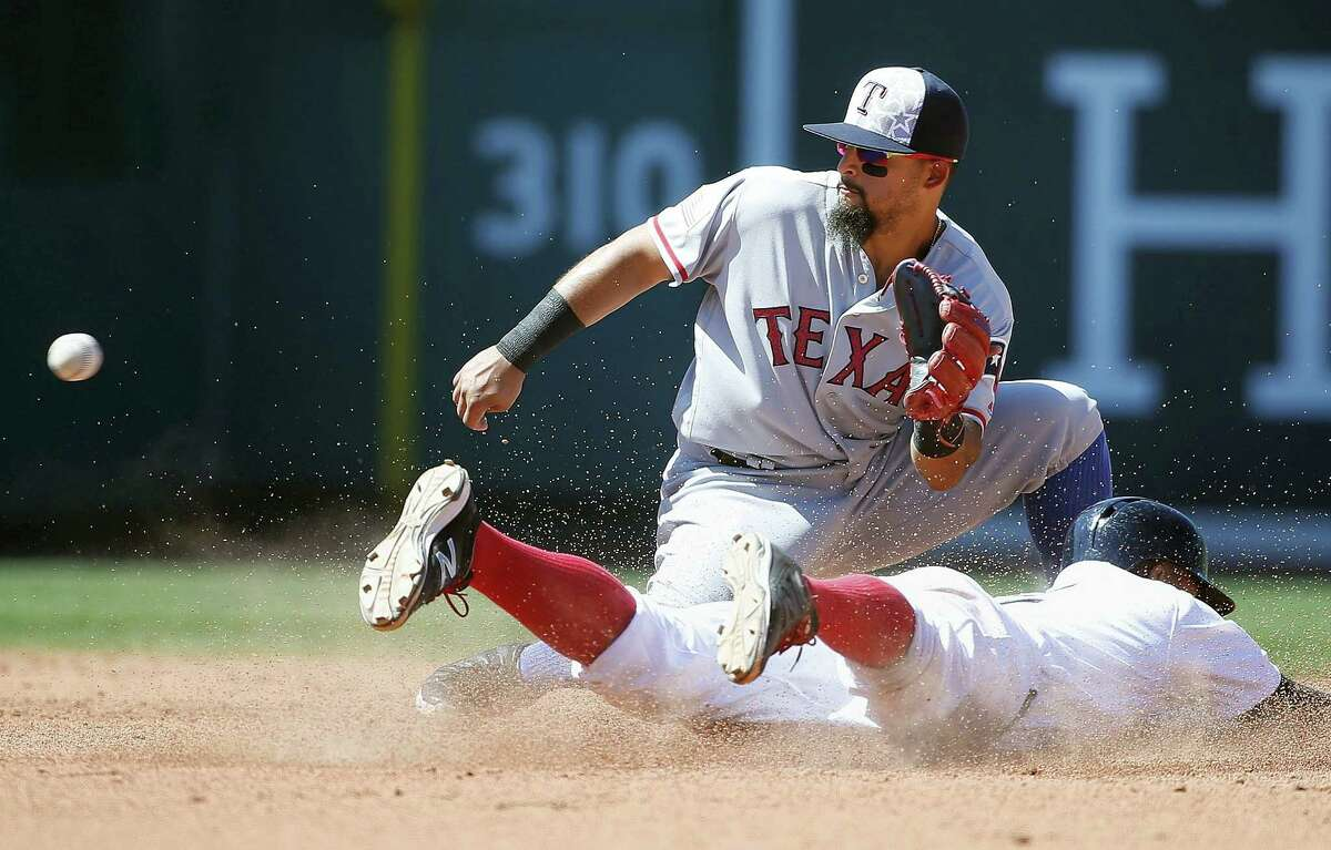 Boston's Xander Bogaerts steals second base as Texas' Rougned Odor waits for the throw during the fourth inning.