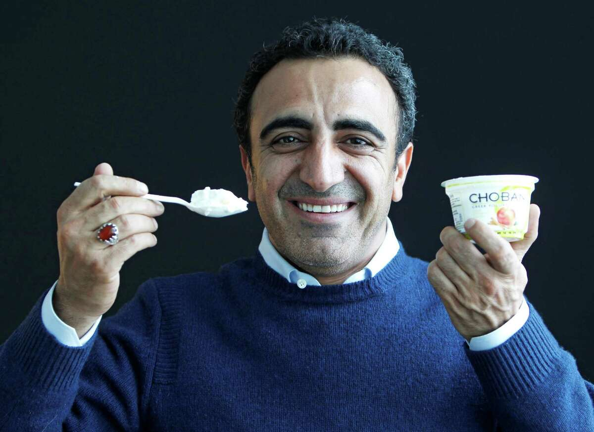 In this Jan. 13, 2012 photo, Hamdi Ulukaya, CEO of Chobani Greek Yogurt, poses at the Chobani plant in South Edmeston, N.Y. Greek yogurt now accounts for a quarter of the total yogurt market after a dizzying growth spurt that is especially apparent here in the heart of upstate New York. The nation's No. 1 and No. 2 Greek yogurt brands ó Chobani and Fage, respectively ó are both expanding plants within 60 miles of each other, and another company is building a plant in western New York. The expansions come as the big U.S. yogurt makers are focusing on Greek products, too.