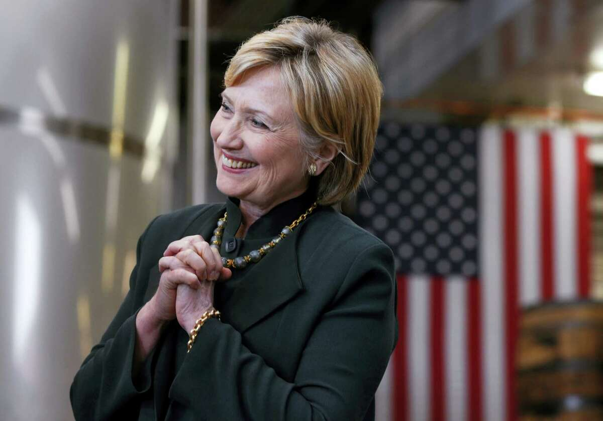 Democratic presidential candidate Hillary Clinton listens during a campaign stop at Jackie O's Production Brewery and Tap Room in Athens, Ohio, Tuesday.