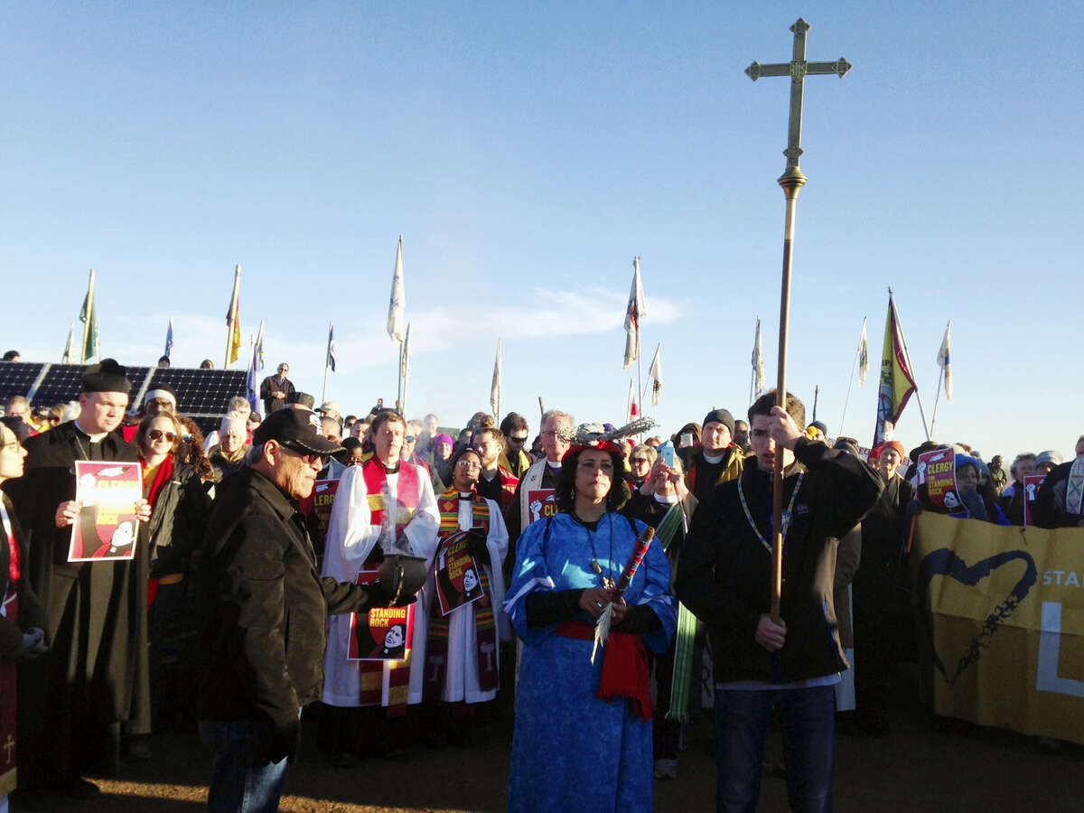 Members of the clergy join protesters against the Dakota Access oil pipeline in southern North Dakota near Cannon Ball on Thursday, Nov. 3, 2016, to draw attention to the concerns of the Standing Rock Sioux and push elected officials to call for a halt to construction. The tribe says the $3.8 billion, four-state pipeline threatens its drinking water and cultural sites.