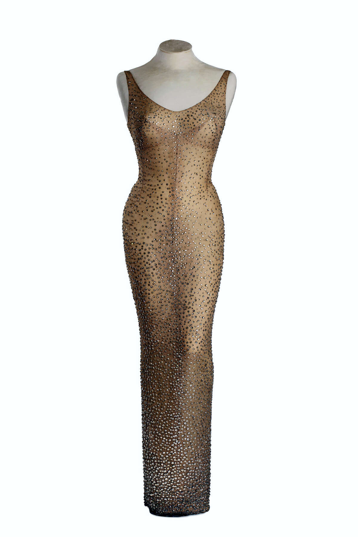 """This undated photo provided by Julien's Auctions shows the flesh-colored dress Marilyn Monroe wore during her rendition of """"Happy Birthday"""" to President John F. Kennedy. Julien'Äôs Auctions is offering the sequined stunner in Los Angeles on Nov. 17, 2016."""