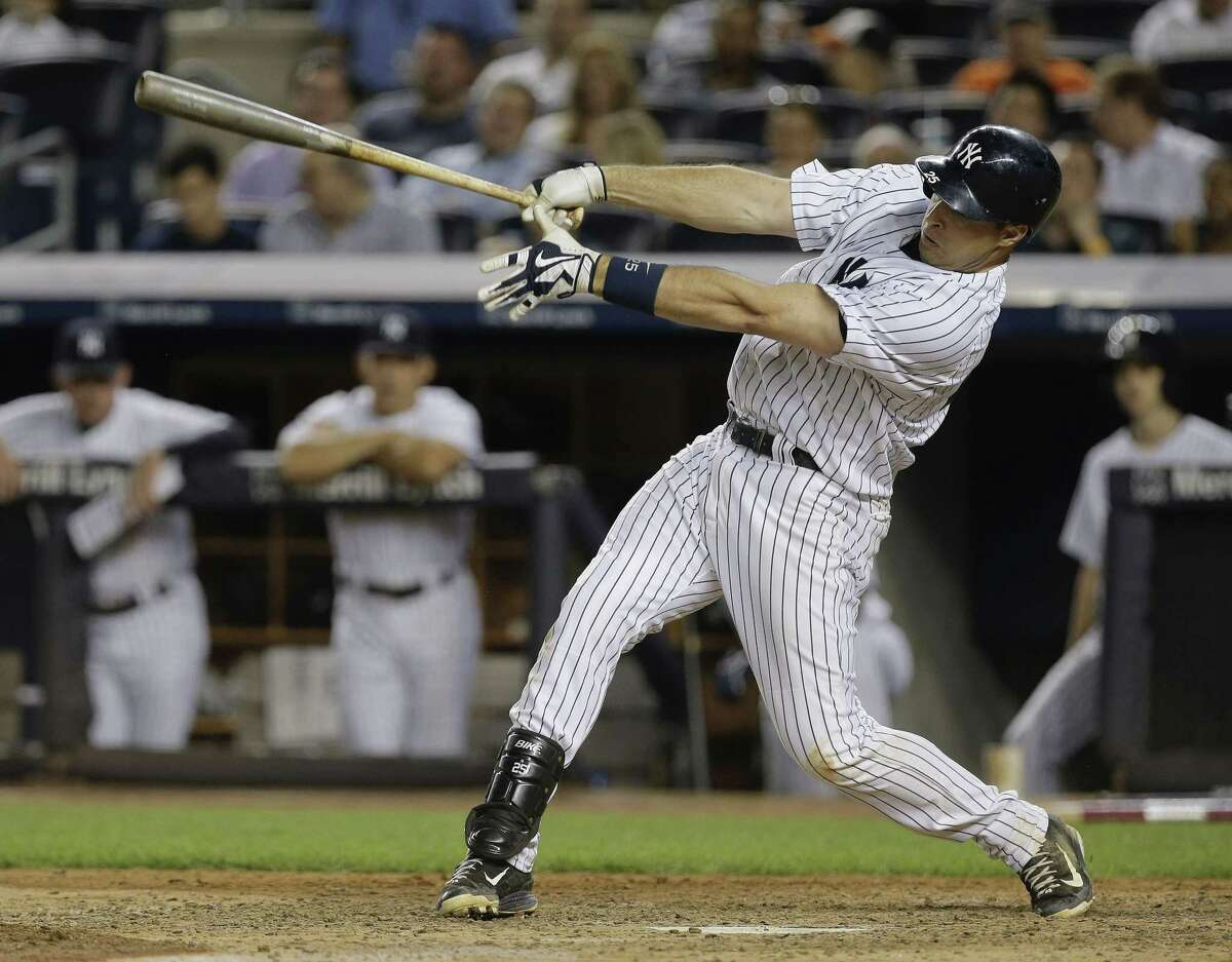 New York Yankees' Mark Teixeira swings on a double against the Baltimore Orioles during the eighth inning of a baseball game, Wednesday, July 22, 2015, in New York. The Yankees won 4-3. (AP Photo/Julie Jacobson)