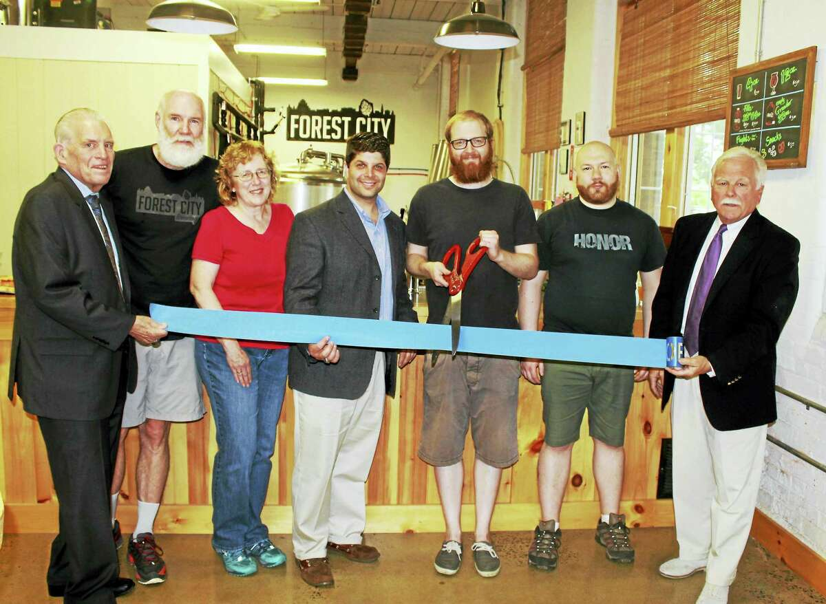 Middlesex County Chamber of Commerce President Larry McHugh, parents Anne-Marie Coughlin and Donald Coughlin, Middletown Mayor Dan Drew, owner and brewer Chris Coughlin, brother Daniel Coughlin and Middletown Small Business Development Counselor Paul Dodge attended the grand opening of Forest City Brewing on June 23.