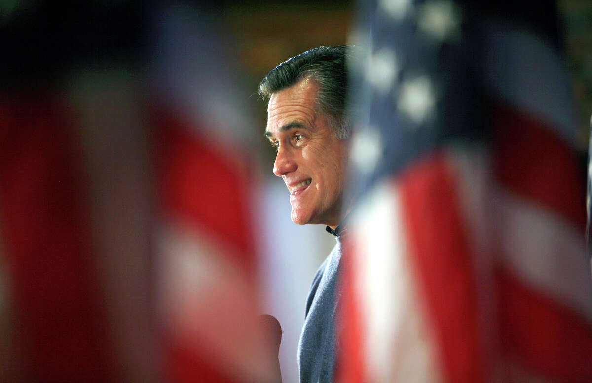 Republican presidential hopeful former Massachussets Gov. Mitt Romney speaks to local residents during a campaign stop Saturday, Dec. 15, 2007, in Humboldt, Iowa.