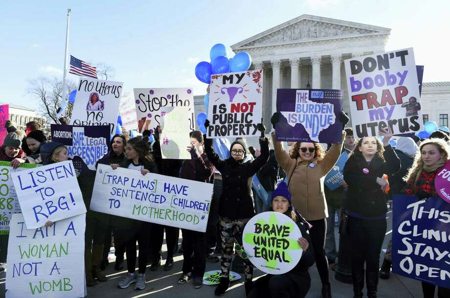 Pro-abortion rights protesters rally outside the Supreme Court in Washington on March 2, 2016. The abortion debate is returning to the Supreme Court in the midst of a raucous presidential campaign and less than three weeks after Justice Antonin Scalia's death. The justices are taking up the biggest case on the topic in nearly a quarter century and considering whether a Texas law that regulates abortion clinics hampers a woman's constitutional right to obtain an abortion. Photo: AP Photo/Susan Walsh  / AP