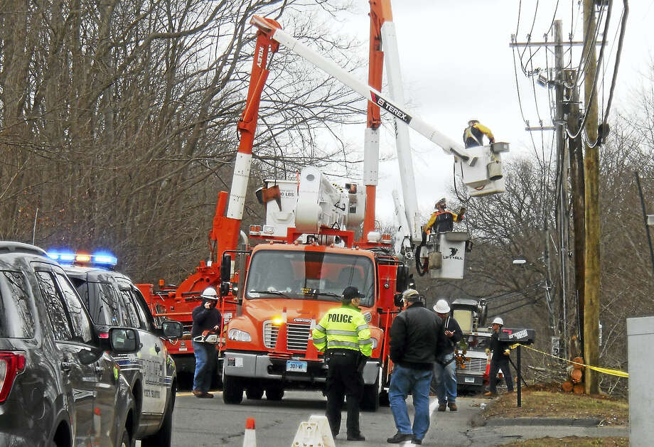 Part of Route 17 was shut down north of Mansfield Drive in North Branford late Thursday morning as crews wroked to repair damage from the strong storm that swept through Greater New Haven the night before. Photo: Wes Duplantier -- New Haven Register