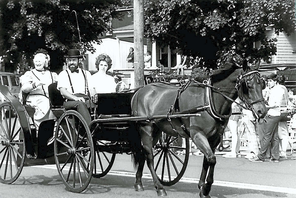 The Portland's Fire Department's 100th anniversary parade was held on June 23, 1984. Dorothy Robinson, president of the Portland Historical Society, rides in a horse-drawn carriage.