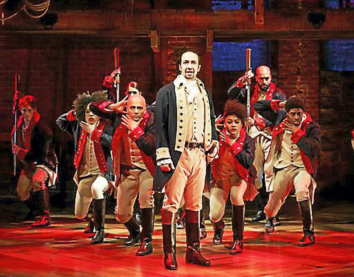 """This image released by The Public Theater shows Lin-Manuel Miranda, foreground, with the cast during a performance of """"Hamilton,"""" in New York. """"Hamilton,"""" the hip-hop stage biography of Alexander Hamilton won the 2016 Pulitzer Prize for drama on Monday, April 18, 2016."""