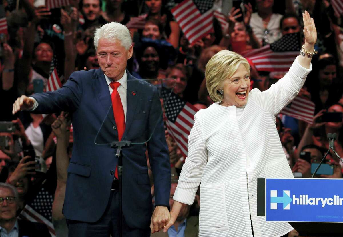 In this June 7 file photo, former President Bill Clinton, left, stands on stage with his wife, Democratic presidential candidate Hillary Clinton, after she spoke during a presidential primary election night rally in New York.