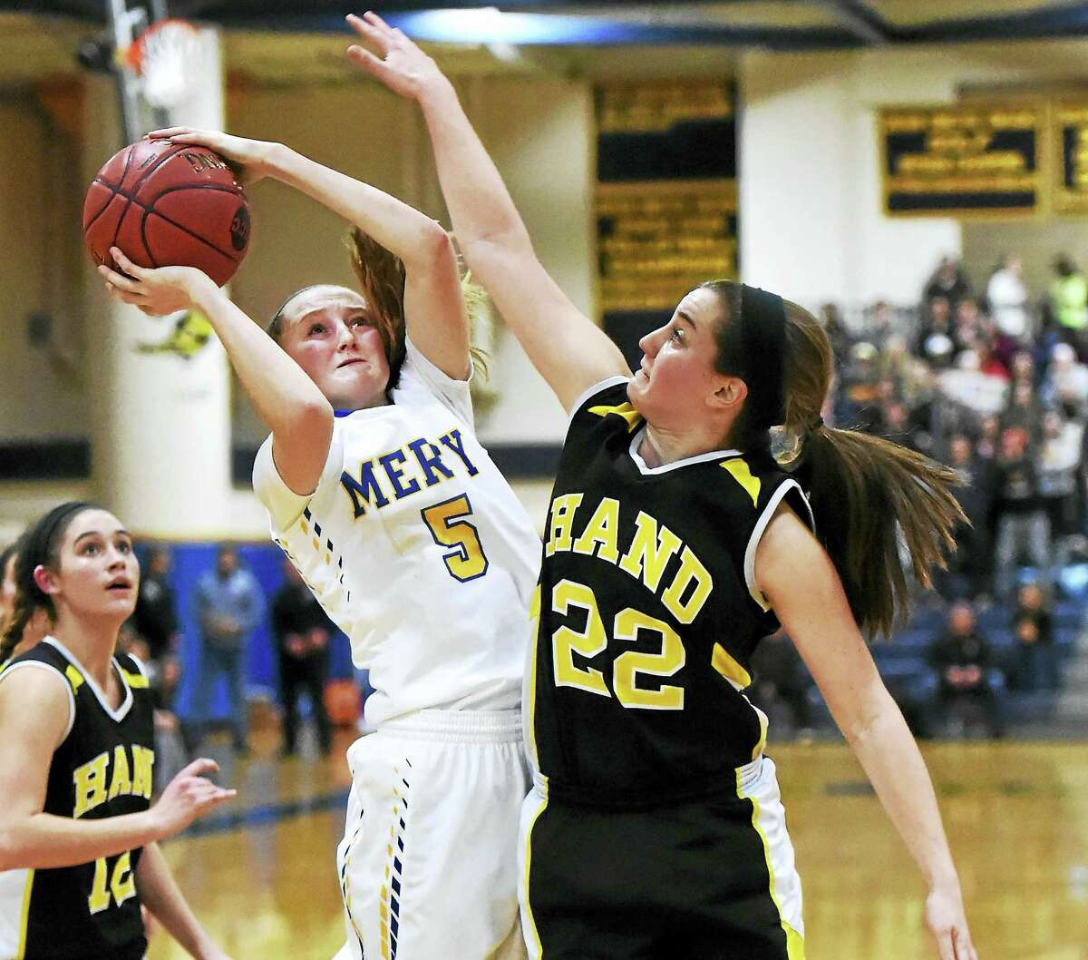 Peter Hvizdak — GameTime CT Mercy's Isabella Santoro has her shot blocked by Paula Materin of Hand during the fourth guarter of the SCC girls basketball championship Wednesday at East Haven High School.