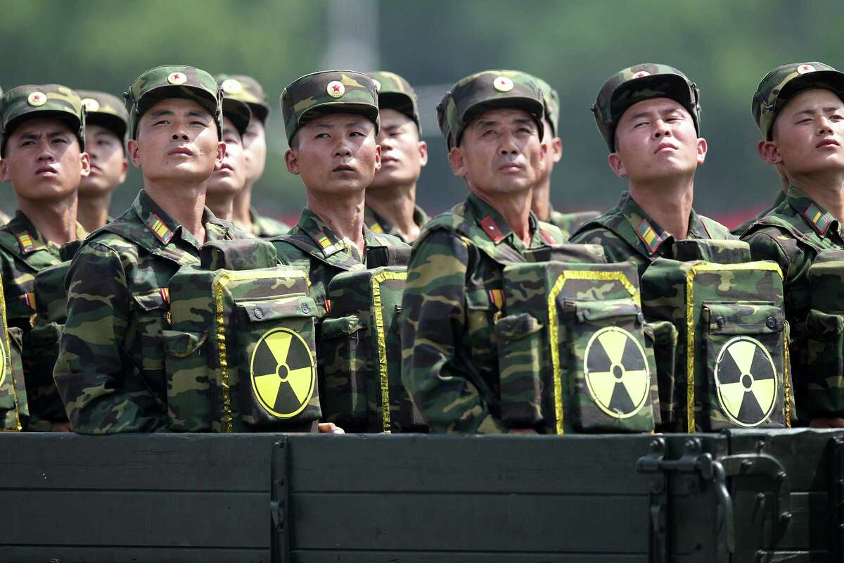 In this July 27, 2013, file photo, North Korean soldiers turn and look towards leader Kim Jong Un as they carry packs marked with the nuclear symbol as they parade during a ceremony marking the 60th anniversary of the Korean War armistice in Pyongyang, North Korea. As North Korea awaits the United Nationsí response to its purported first H-bomb test, Washington is believed to be floating measures that could cause it some serious problems. They range from a ban on selling the North oil or buying its minerals to excluding banks doing business with it from accessing the dollar-based economy or even barring its flagship airline from entering other countriesí airspace.
