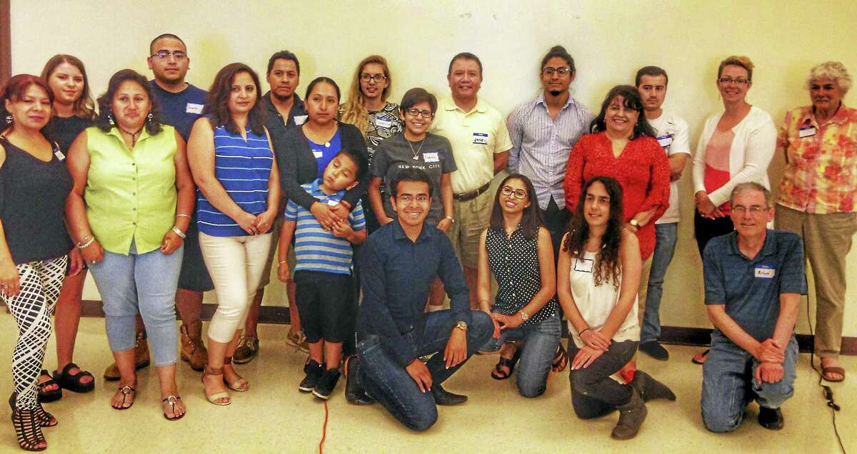 An immigration program established in 2012 can give undocumented youth a work permit and a Social Security number. Shown here are those involved in a recent program.