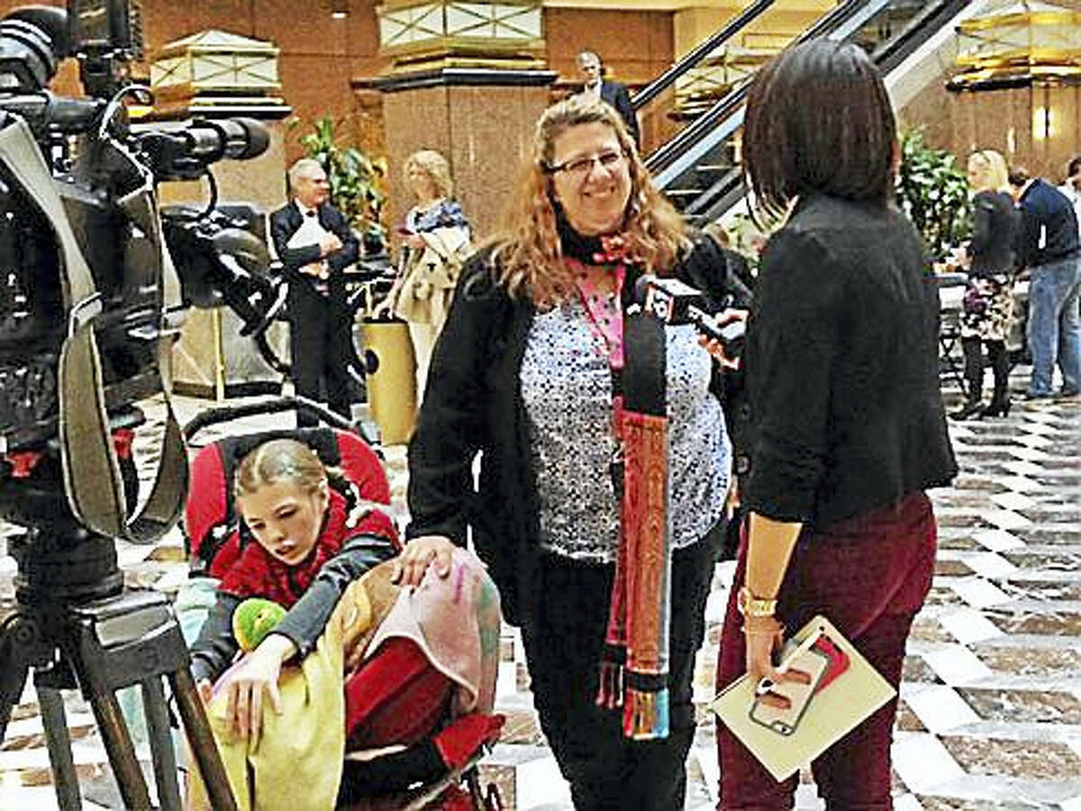 Susan Meehan and her daughter Cyndemae talk to reporters at the Legislative Office Building.