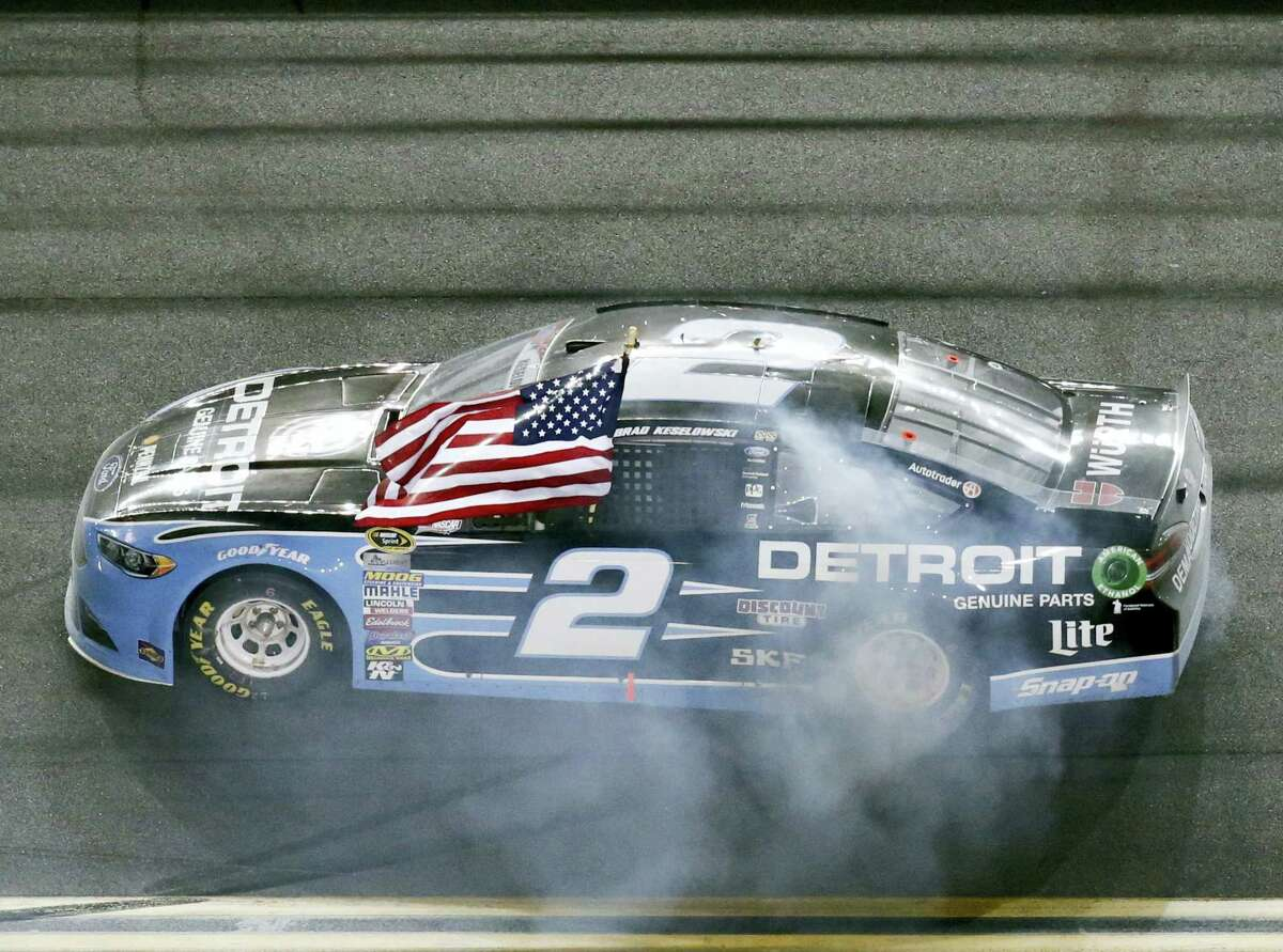 Brad Keselowski celebrates after winning at Daytona International Speedway Saturday.
