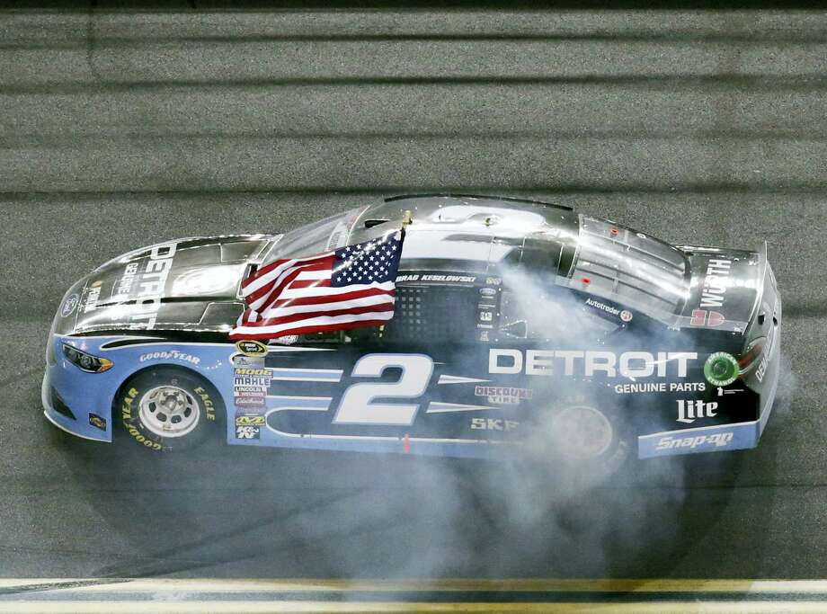 Brad Keselowski celebrates after winning at Daytona International Speedway Saturday. Photo: Wilfredo Lee — The Associated Press  / Copyright 2016 The Associated Press. All rights reserved. This material may not be published, broadcast, rewritten or redistribu