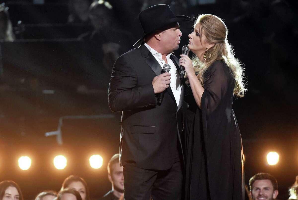 Garth Brooks, left, and Trisha Yearwood perform at the 50th annual CMA Awards at the Bridgestone Arena on Nov. 2, 2016 in Nashville, Tenn.