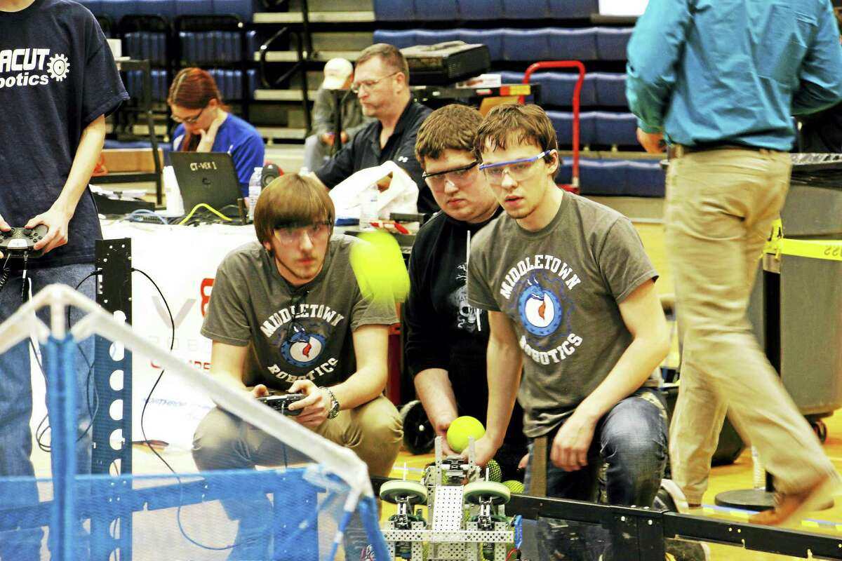 Students Zachary Fitzner, Michael Lentini and Thomas Hale compete on Middletown High School's team 9909a Saturday during the VEX Robotics State Qualifier.
