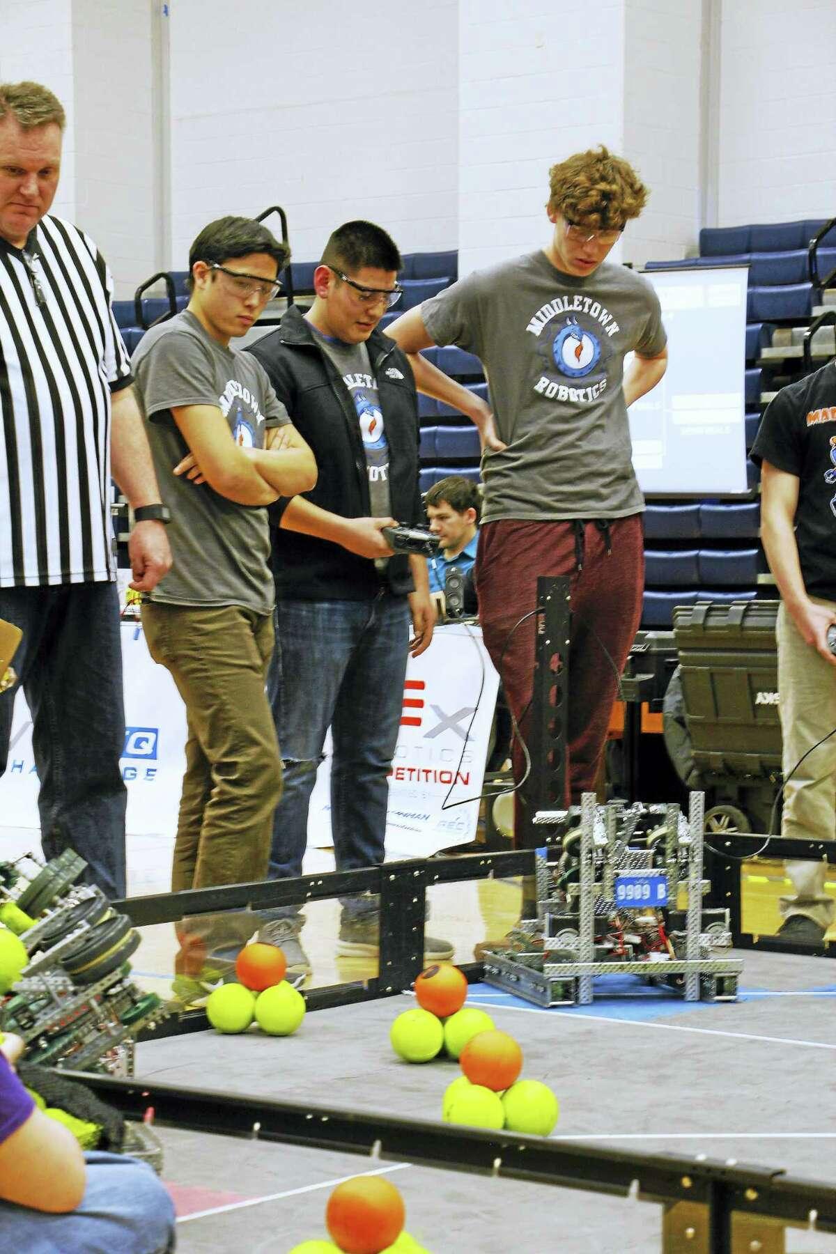Courtesy photo Members of the Robotics Team 9909b, from left, are Daniel Feener, David Valencia and Nathaniel Spencer.