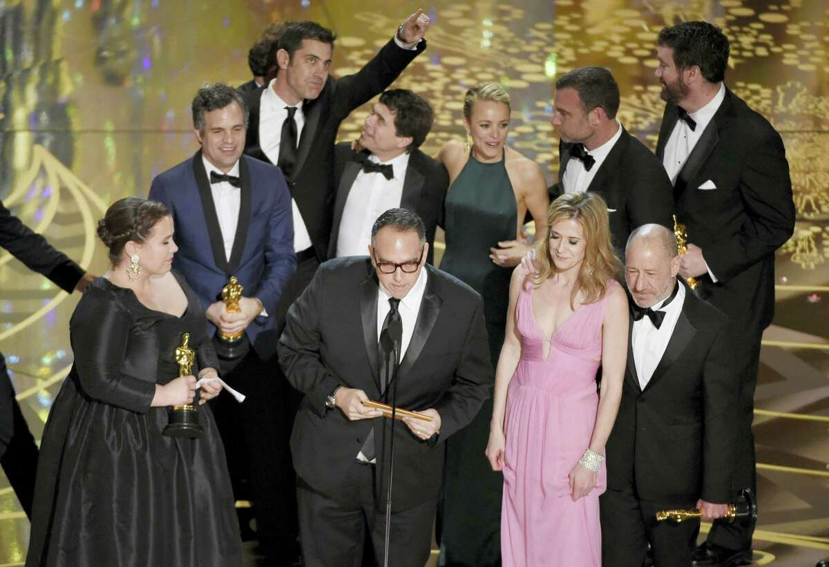 """Nicole Rocklin, front row from left, Michael Sugar, Blye Pagon Faust, Steve Golin, and, second row from left, Mark Ruffalo, Josh Singer, Michael Rezendes, Rachel Mc Adams and Liev Schrieber appear on stage to accept the award for best picture for """"Spotlight"""" at the Oscars on Sunday at the Dolby Theatre in Los Angeles."""