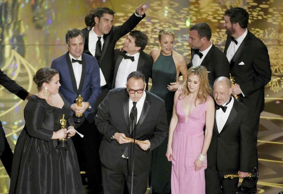 """Nicole Rocklin, front row from left, Michael Sugar, Blye Pagon Faust, Steve Golin, and, second row from left, Mark Ruffalo, Josh Singer, Michael Rezendes, Rachel Mc Adams and Liev Schrieber appear on stage to accept the award for best picture for """"Spotlight"""" at the Oscars on Sunday at the Dolby Theatre in Los Angeles. Photo: The Associated Press  / Invision"""