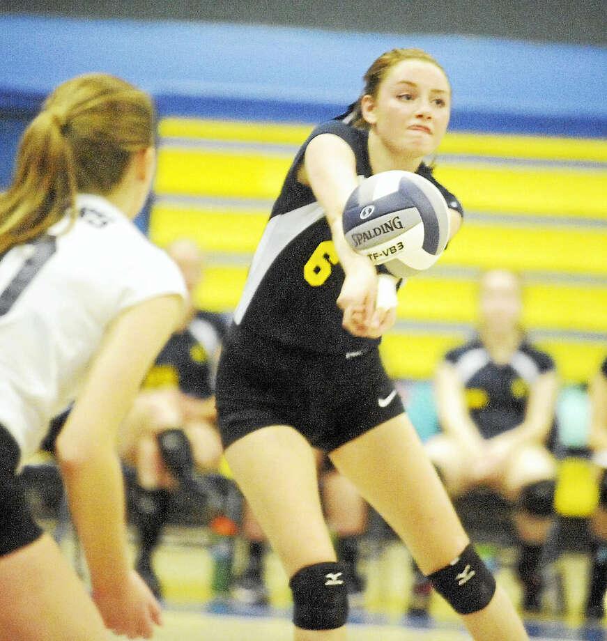 Haddam-Killingworth senior Sarah Porter had nine kills in the Cougars' 3-0 SLC semifinal win over Coginchaug on Wednesday. Photo: Jimmy Zanor - The Middletown Press