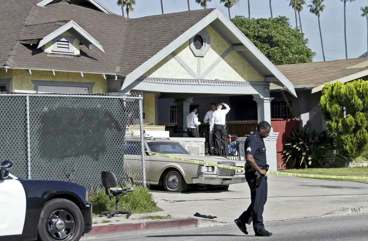Los Angeles police investigate a stabbing at a house in Los Angeles on Tuesday, May 3, 2016. Donald Gray is suspected of stabbing his live-in girlfriend and her 2-year-old daughter in their home, killing the little girl and critically wounding the mother, who was five months pregnant, authorities said.