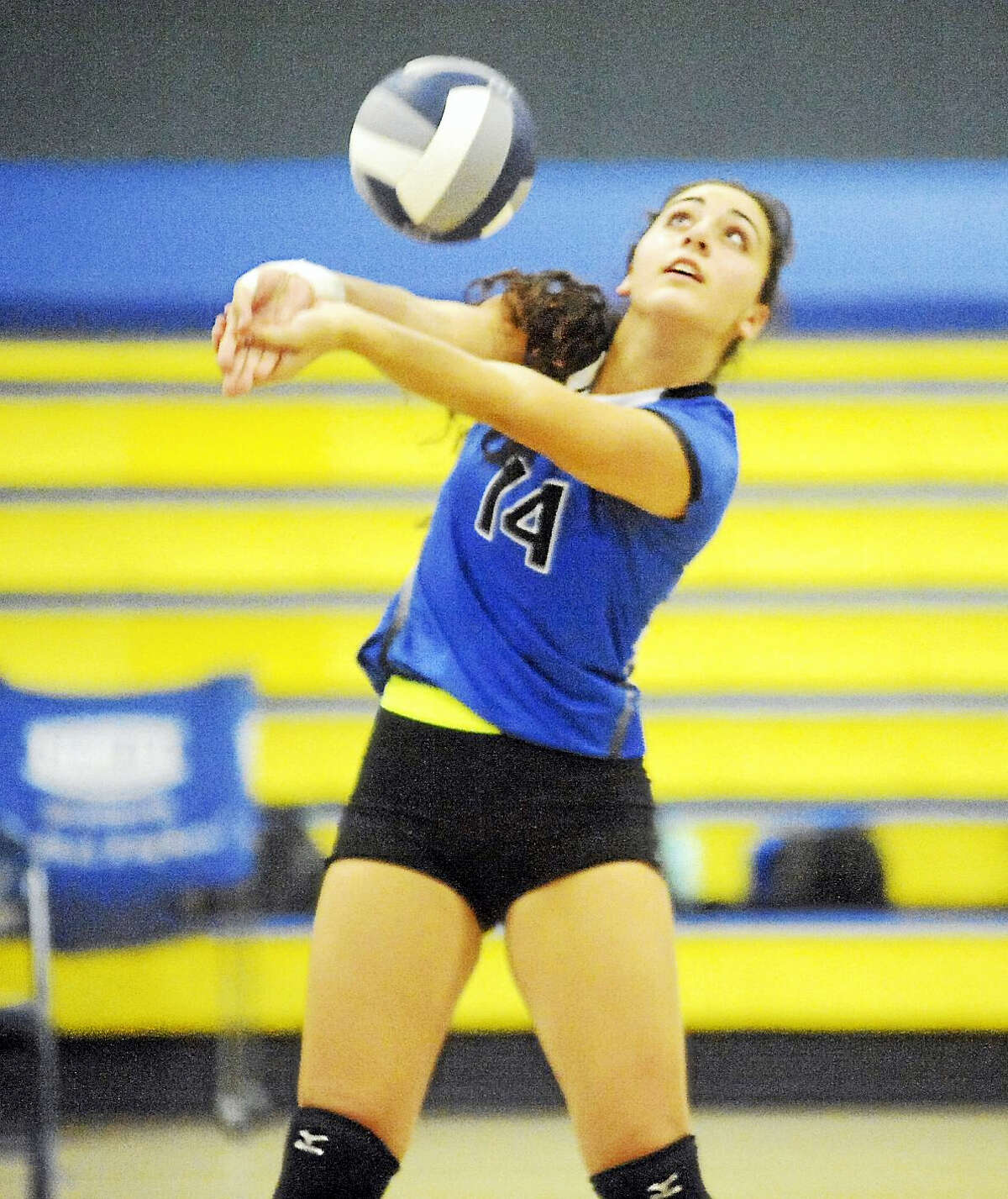 Coginchaug senior Alexa DeFilio delivers a pass against H-K during Wednesday's SLC semifinal.