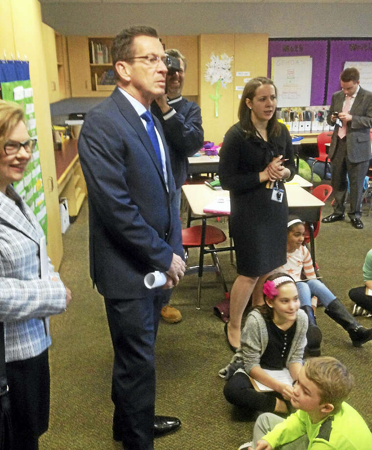 Malloy speaks to students during a tour of the school. Photo: Jeff Mill — The Middletown Press