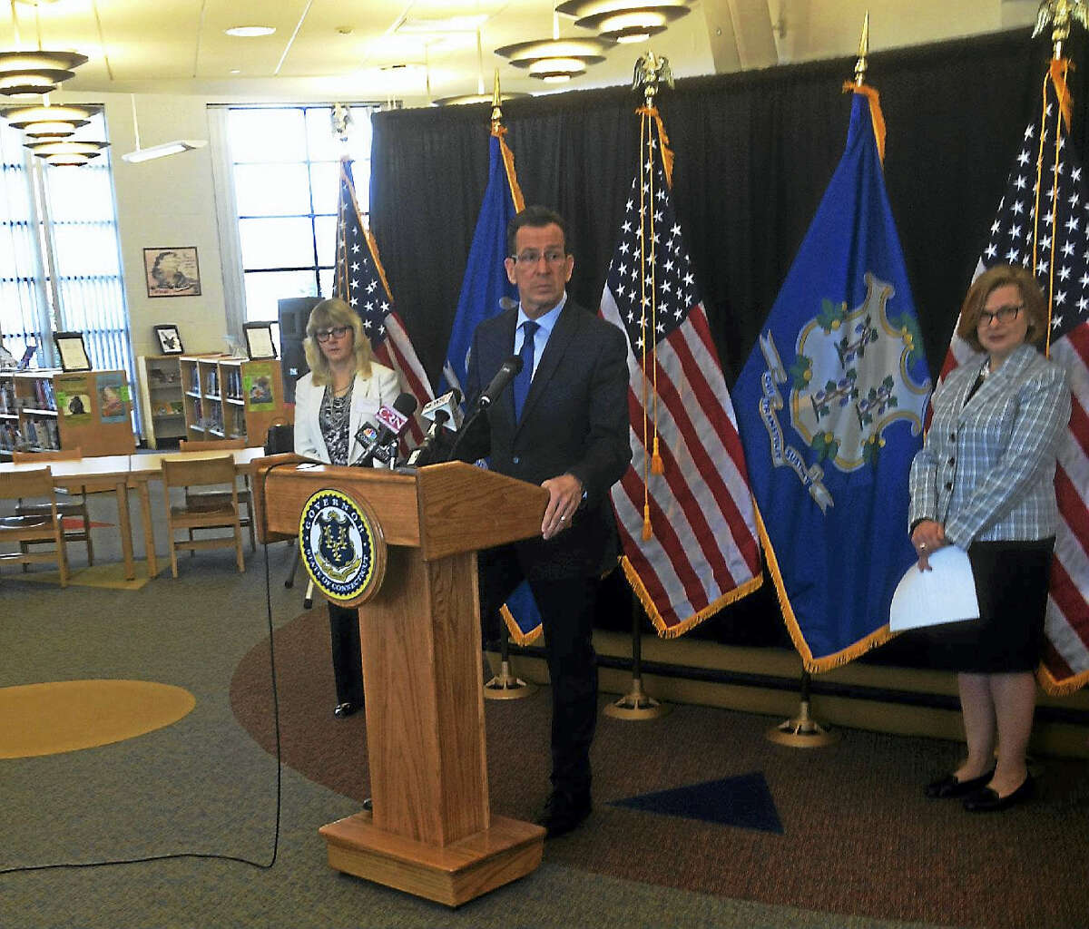 Gov. Dannel P. Malloy speaks to the press Thursday morning at Cromwell's Woodside Intermediate School about the decision to alter a portion of the Smarter Balanced Assessments for grades three to eight after analysis conducted by the school district. Malloy is flanked by Superintendent of Schools Paula Talty, left, and state Education Commissioner Dianna Wentzell.