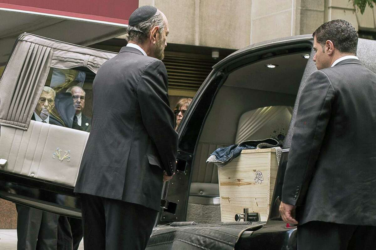 Cantor Joseph Malovany pray in front of Elie Wiesel's coffin during a private service for the Nobel laureate and Holocaust survivor at the Fifth Avenue Synagogue in New York July 3, 2016.