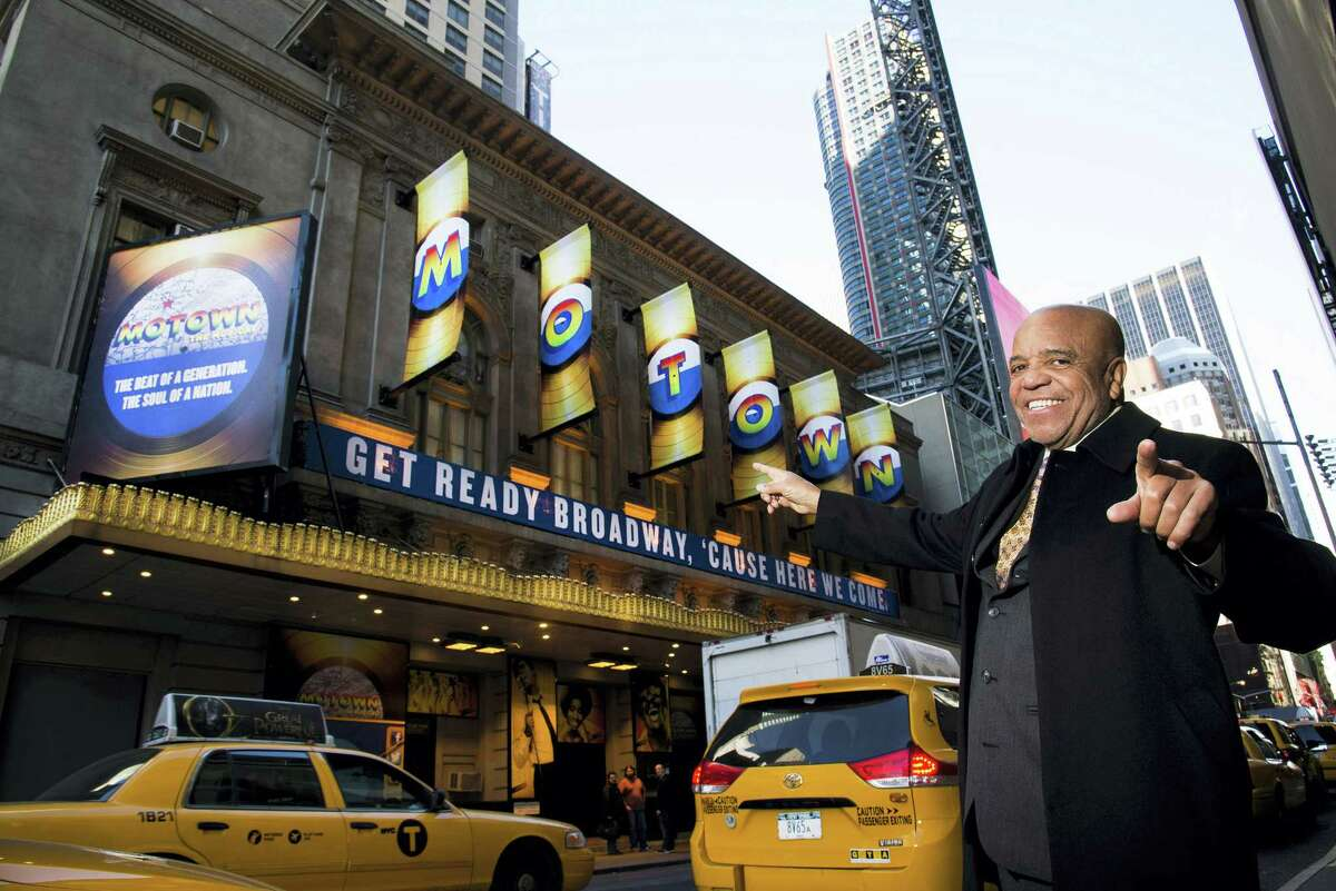 """This March 5, 2013 photo shows Berry Gordy posing for a portrait in front of the Lunt-Fontanne Theatre where """"Motown: The Musical,"""" opened on Broadway in New York."""